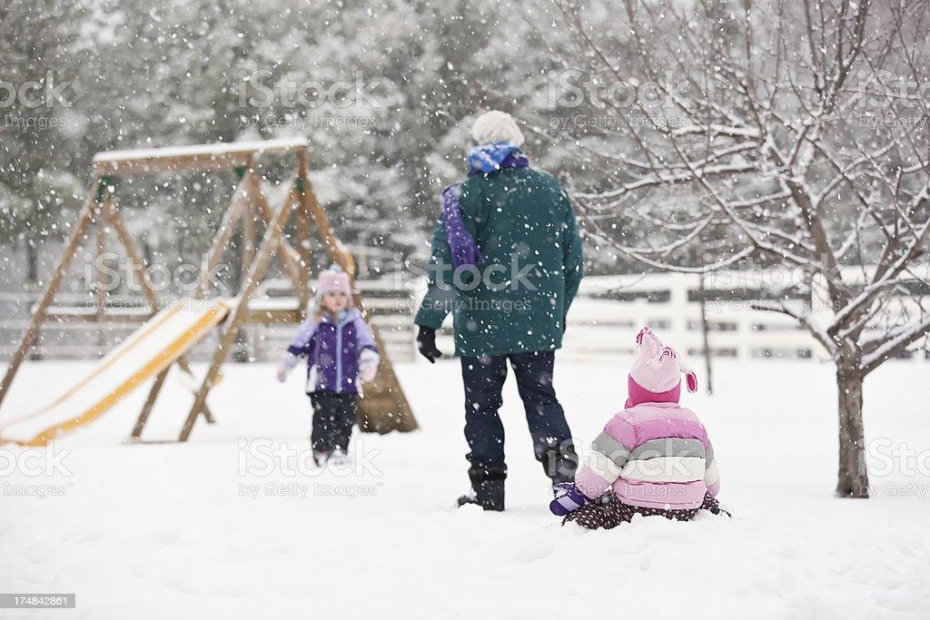 Girls & Grandma Playing in Snow Storm royalty-free stock photo