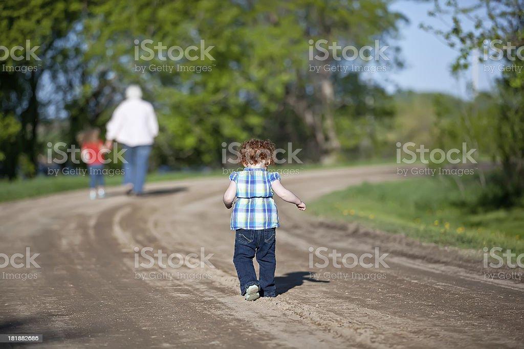 Girls & Grandma Walking Down Rural Driveway royalty-free stock photo