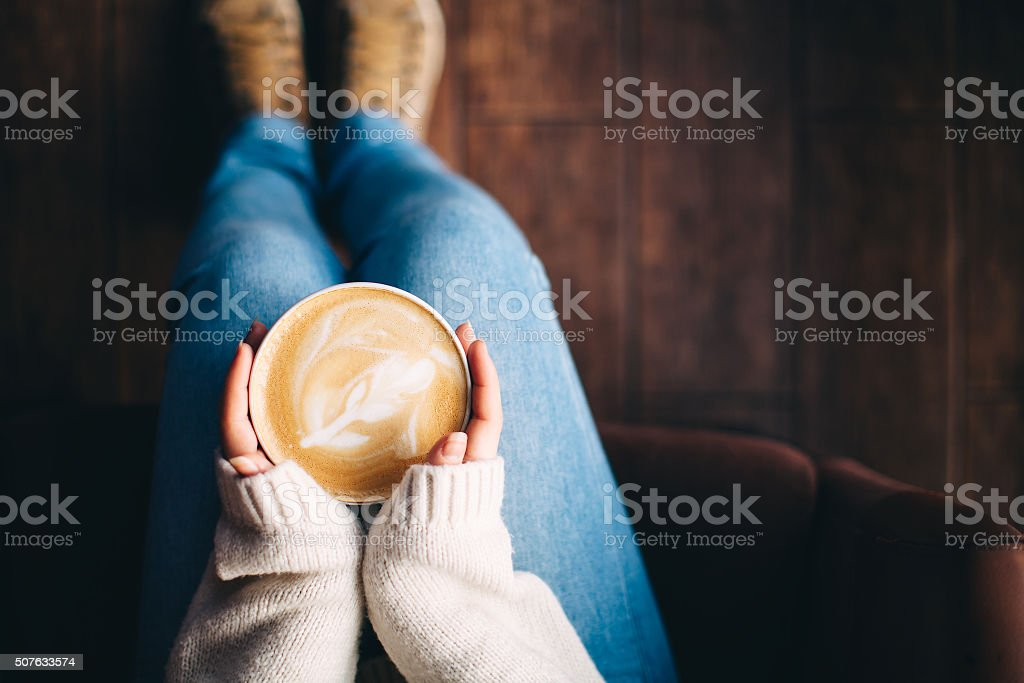 Girl's hands holding a cup of coffee stock photo