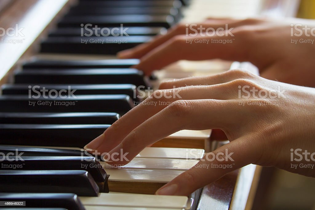 Girl's hands on piano stock photo