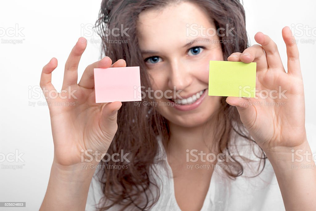 Girl's hands with two slips of paper stock photo