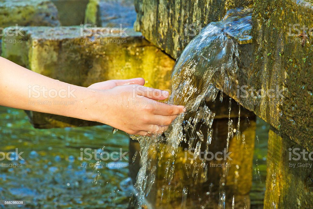 Girls hands with water splash stock photo