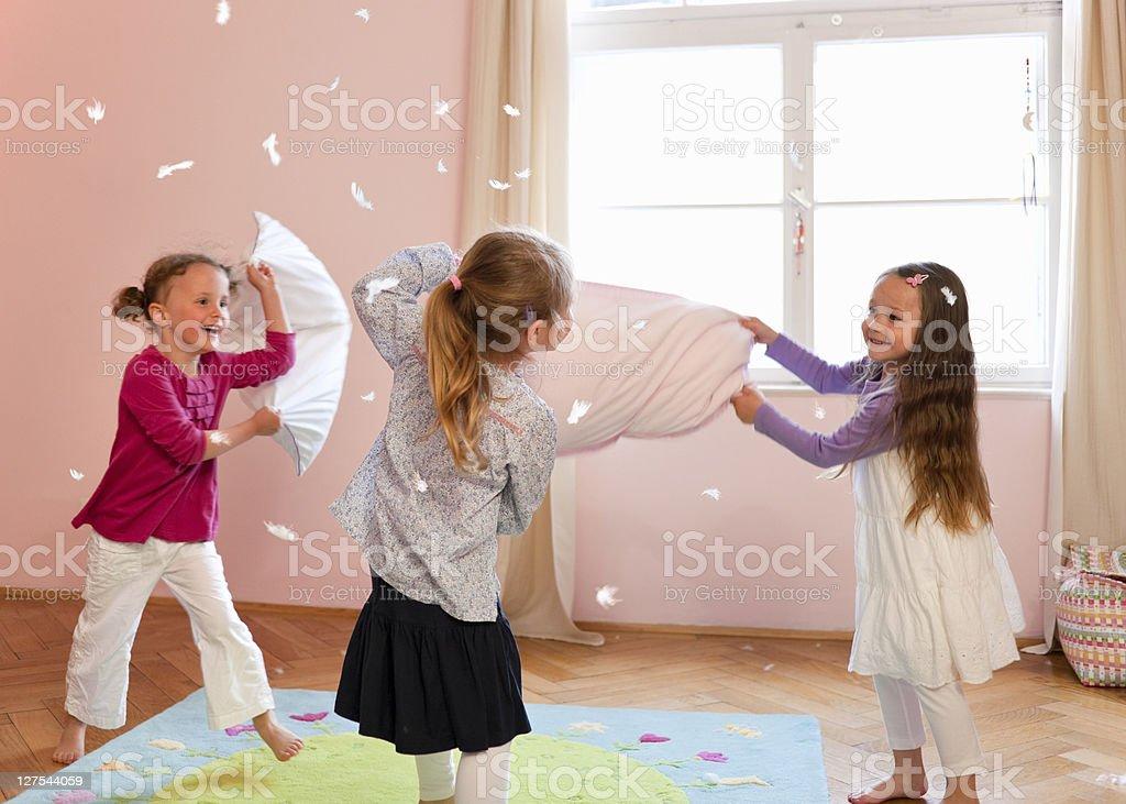 Girls having a pillow fight stock photo