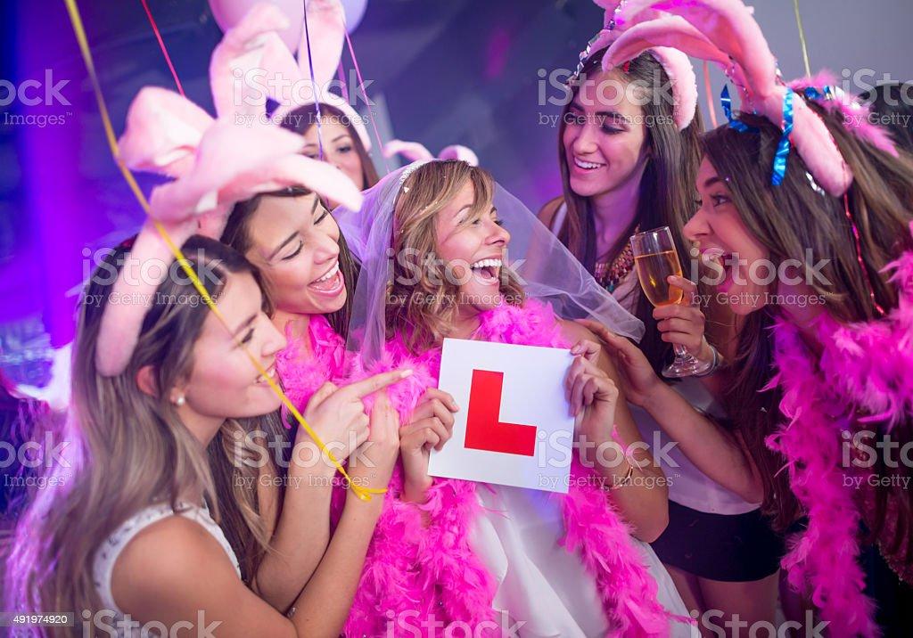 Girls having fun at a bachelorette party stock photo
