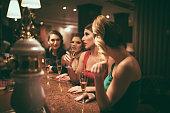 Girls having fun at the bar