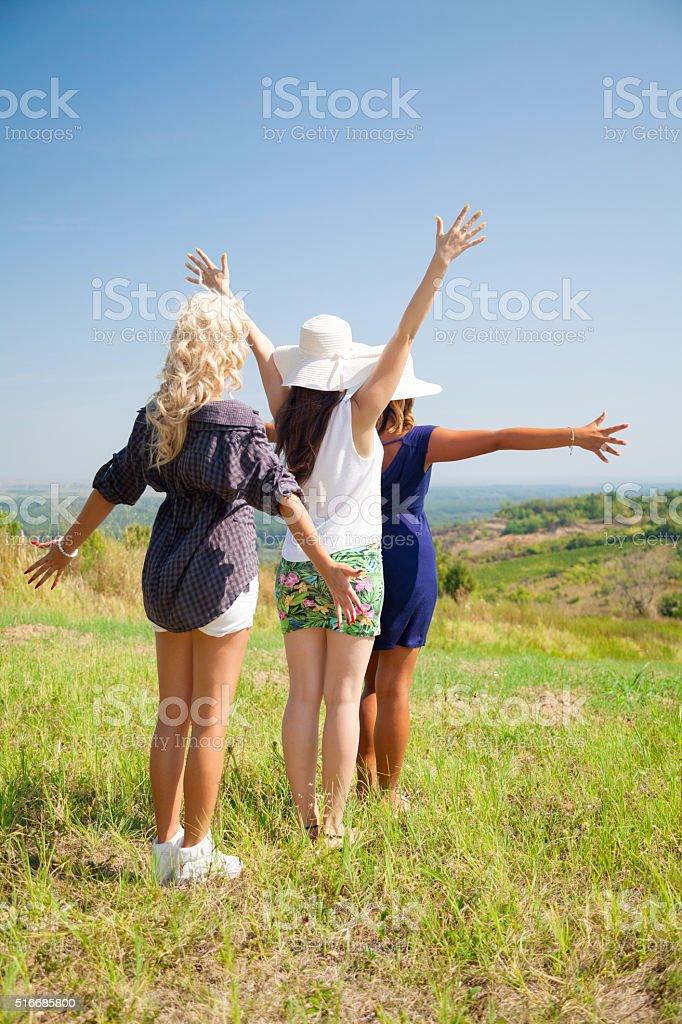 Girls having fun in nature. stock photo