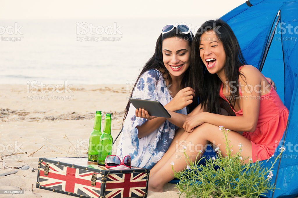 Girls having fun on beach stock photo
