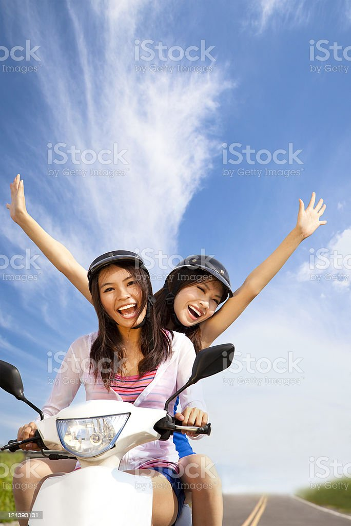girls having summer trip on a scooter royalty-free stock photo