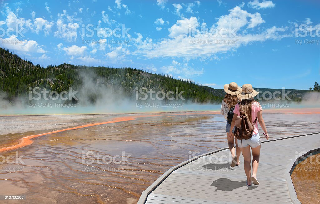 Girls hiking on vacation in beautiful park. stock photo