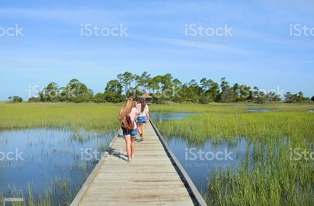 Girls hiking on vacation. stock photo