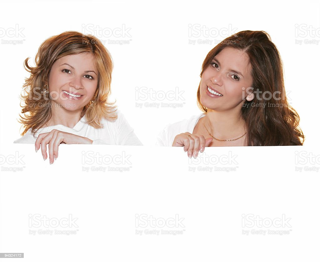 Girls holding a white card stock photo