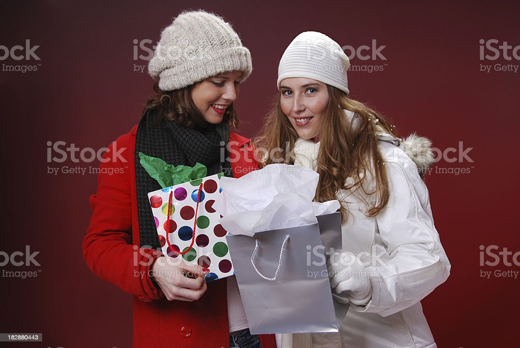 Girls holding Christmas presents royalty-free stock photo