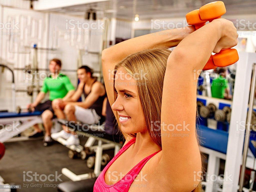 Girls holding dumbbells in sport gym stock photo