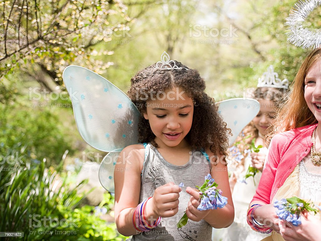 Girls holding flowers stock photo