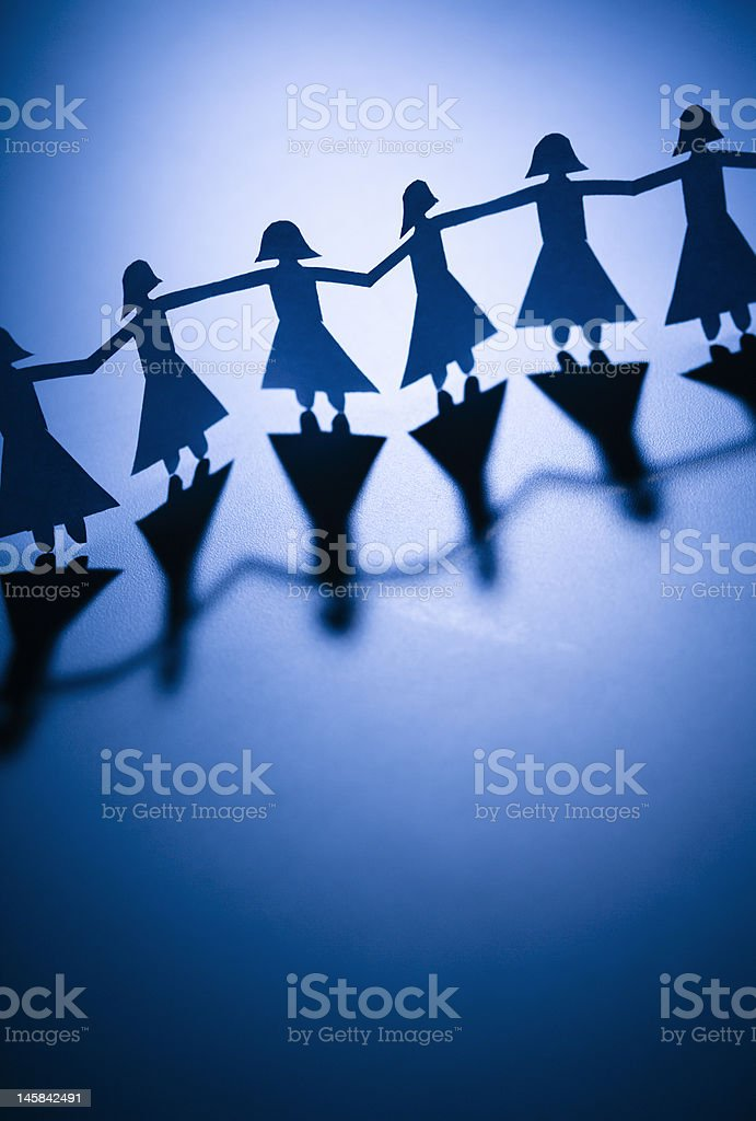 Girls holding hands royalty-free stock photo