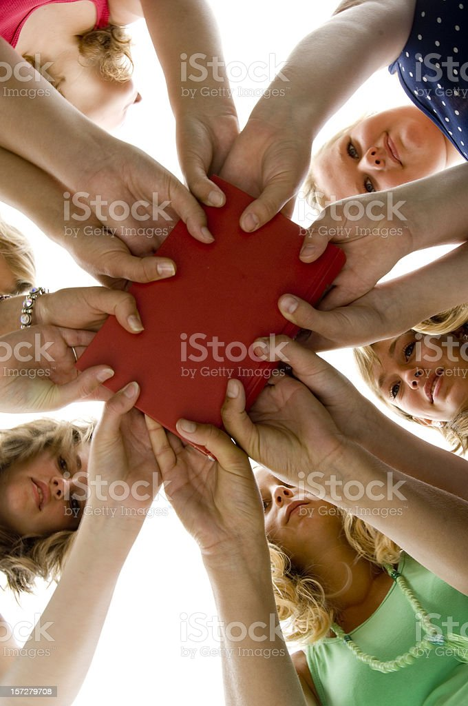 girls holding red book royalty-free stock photo