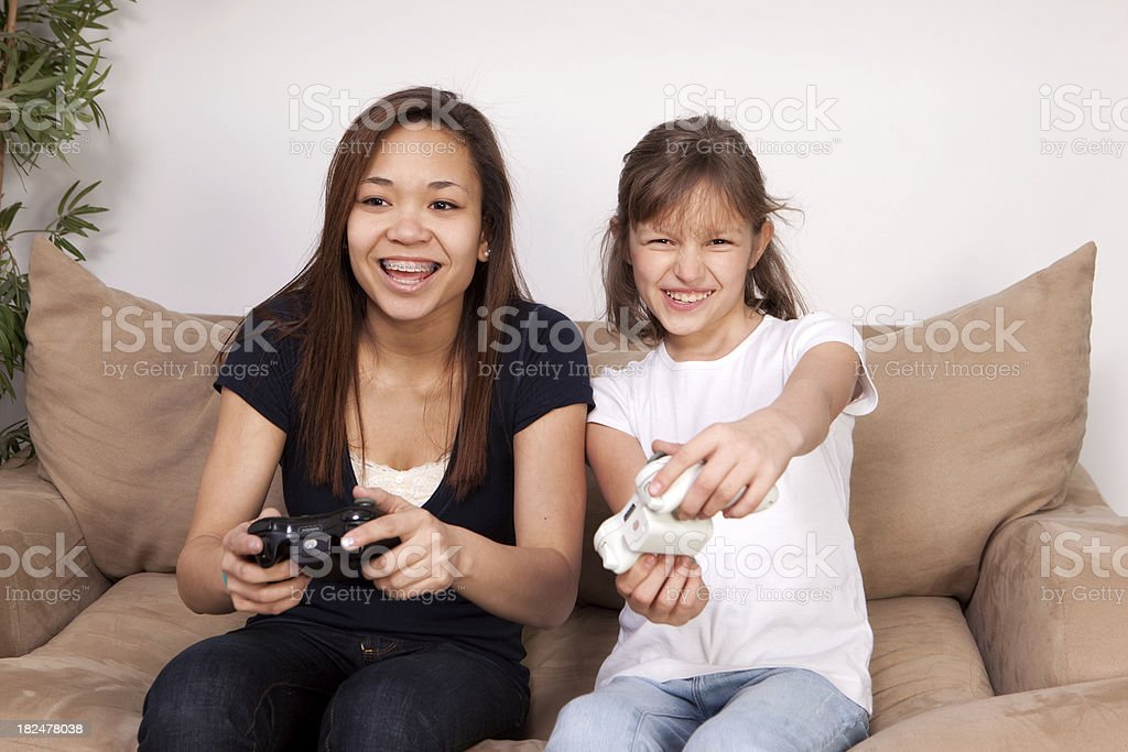 Girls Holding Video Game Controllers royalty-free stock photo