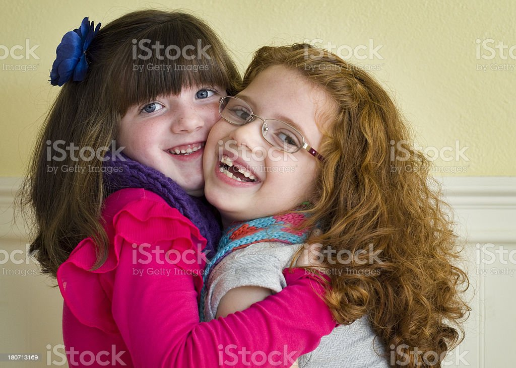 Girls hug each other tightly royalty-free stock photo