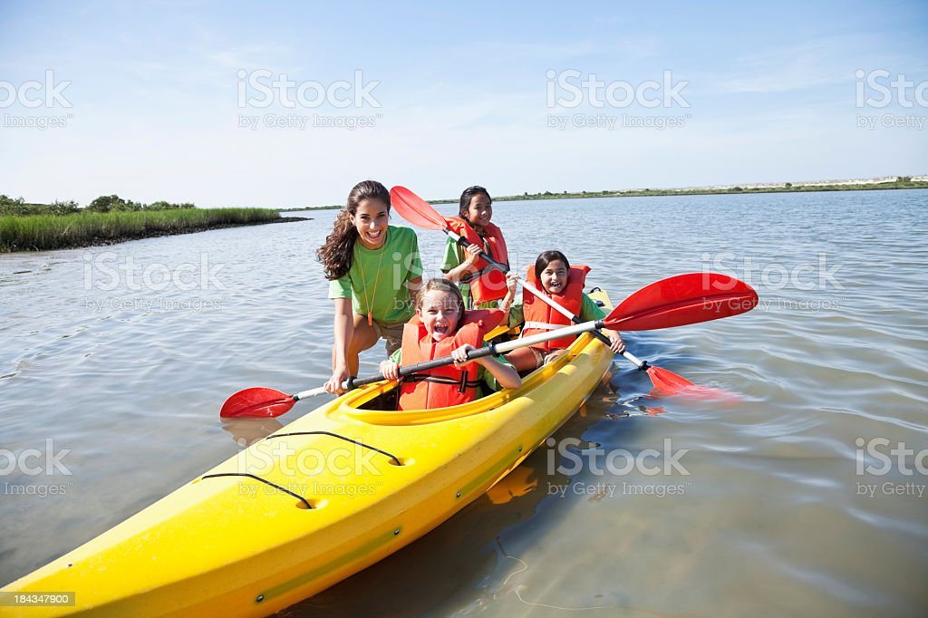 Girls in a double kayak royalty-free stock photo