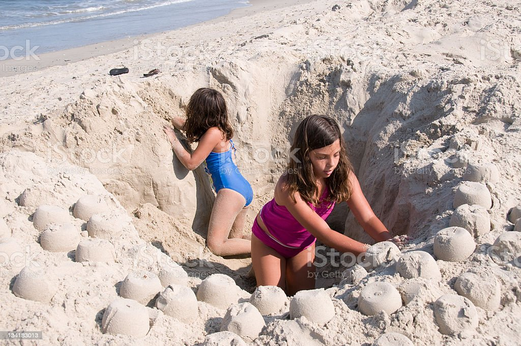 Girls in a Hole royalty-free stock photo