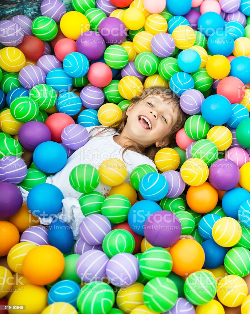 Girls in ball pool stock photo