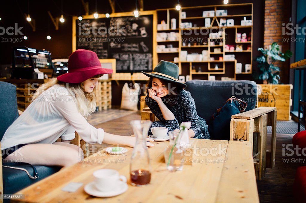Girls in coffee shop stock photo
