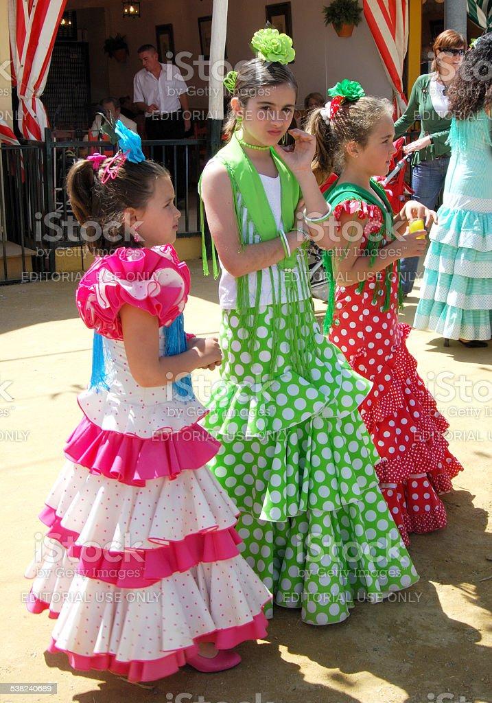 Girls in flamenco dresses. stock photo