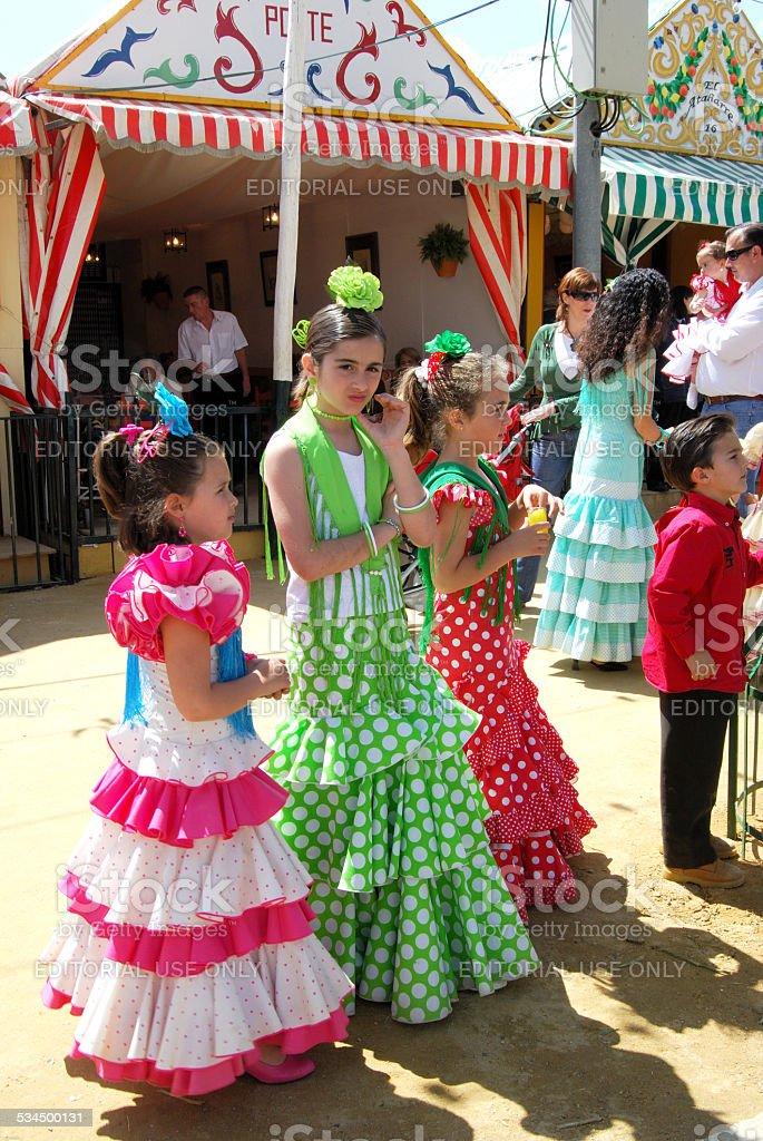 Girls in flamenco dresses, Seville, Spain. stock photo