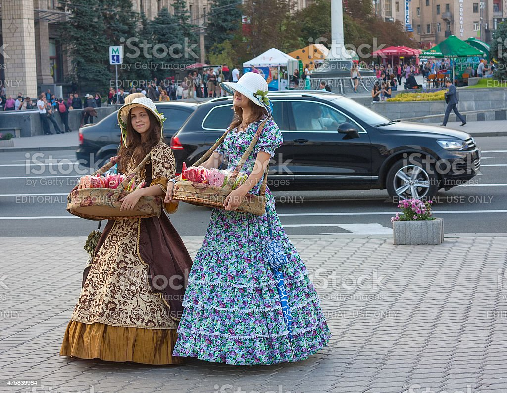 Girls in historical costumes stock photo