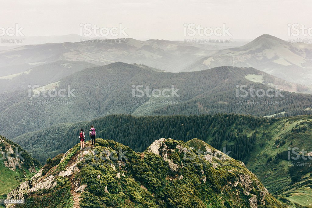 Girls in mountains stock photo