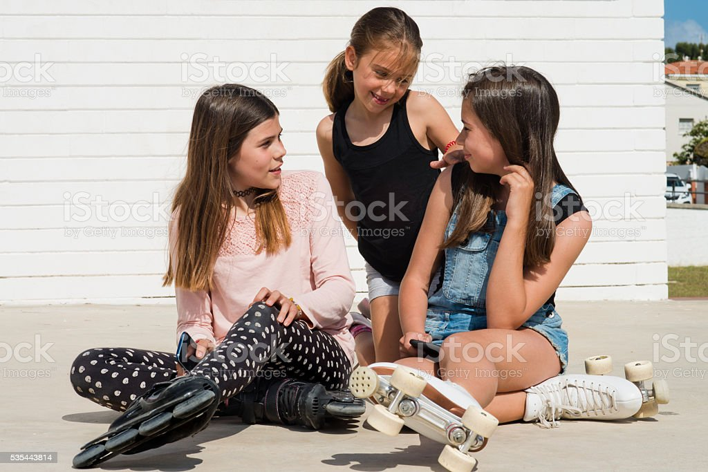 3 girls in the park stock photo