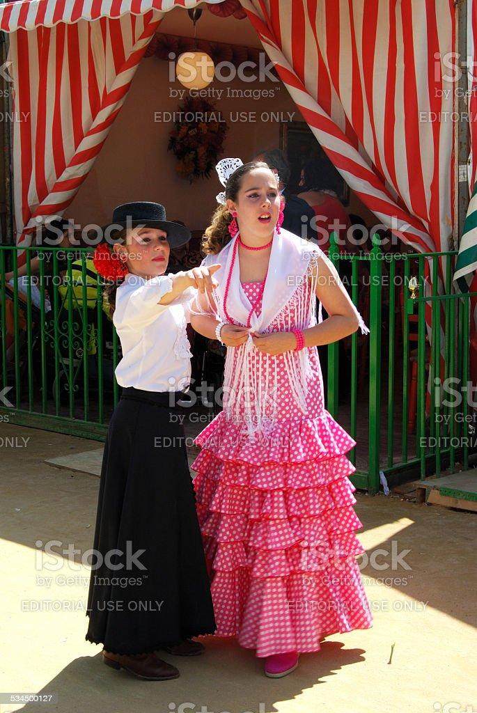 Girls in traditional dress, Seville, Spain. stock photo