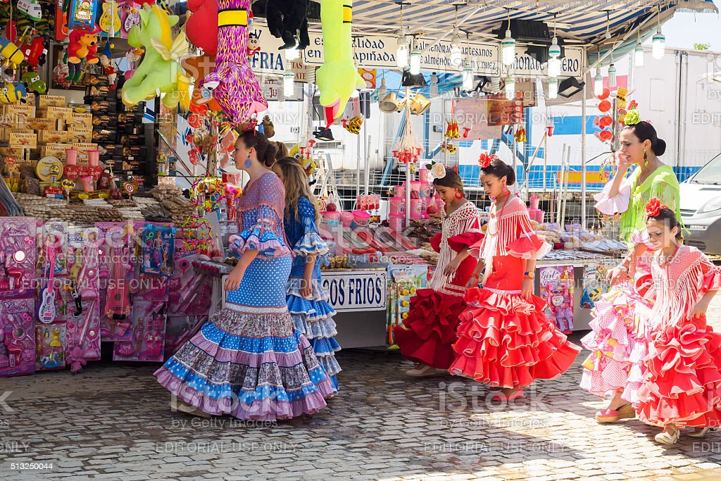 Girls in traditional dress walking at the Seville Fair stock photo
