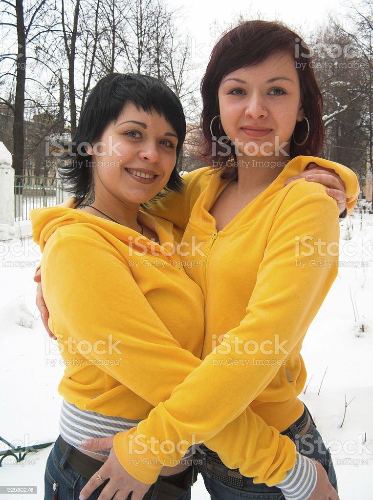Girls in yellow stock photo