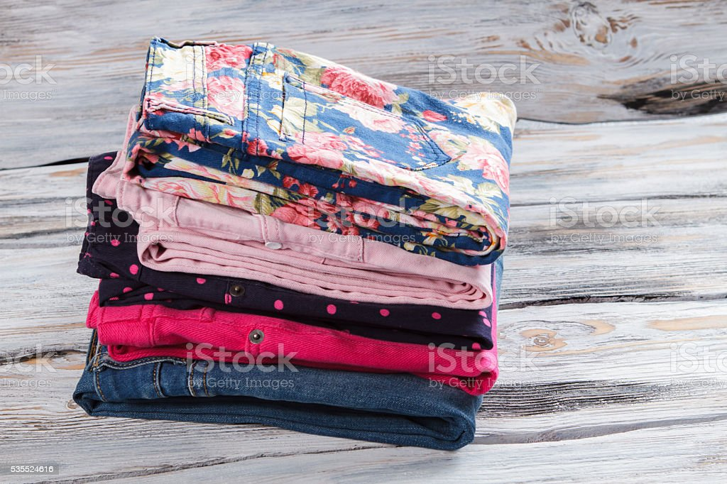 Girl's jeans and floral pants. stock photo