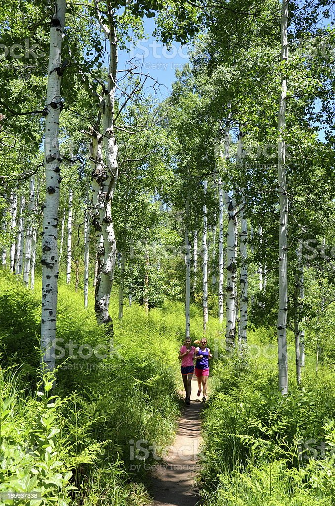 Girls Jogging on a Trail in the Colorado Rocky Mountains stock photo