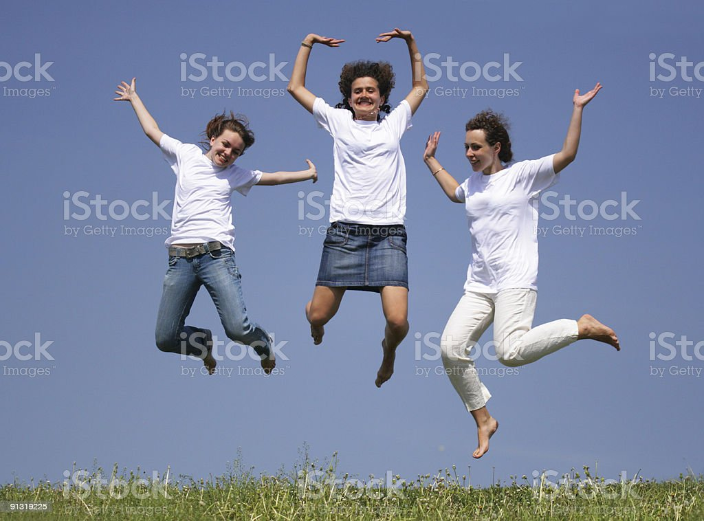 Girls jump royalty-free stock photo