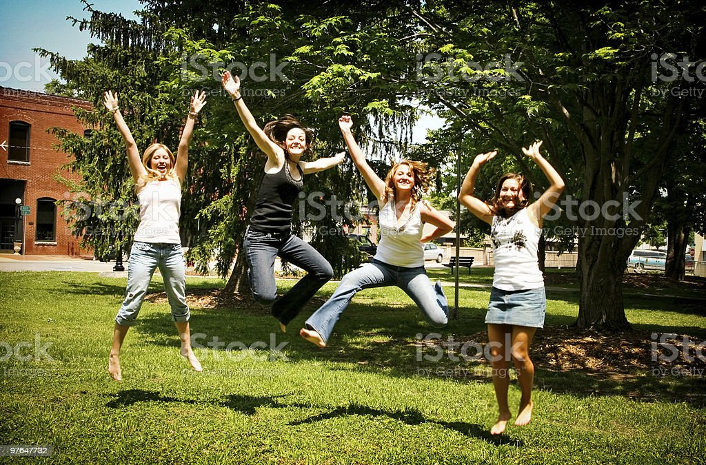 Girls jumping in excitement royalty-free stock photo