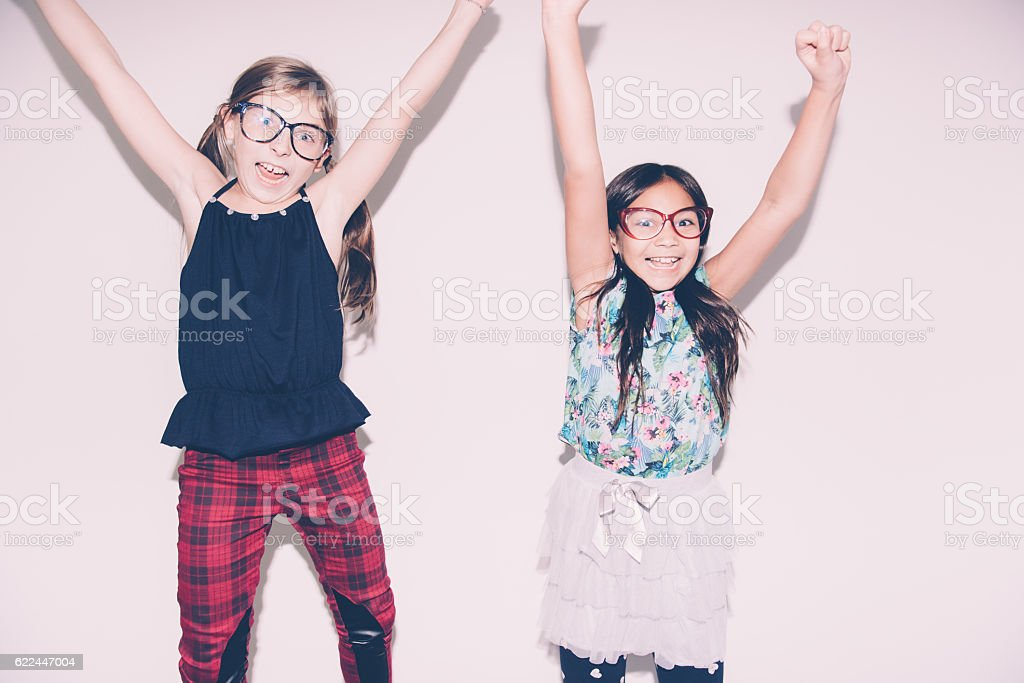 Girls Jumping On The Bed stock photo