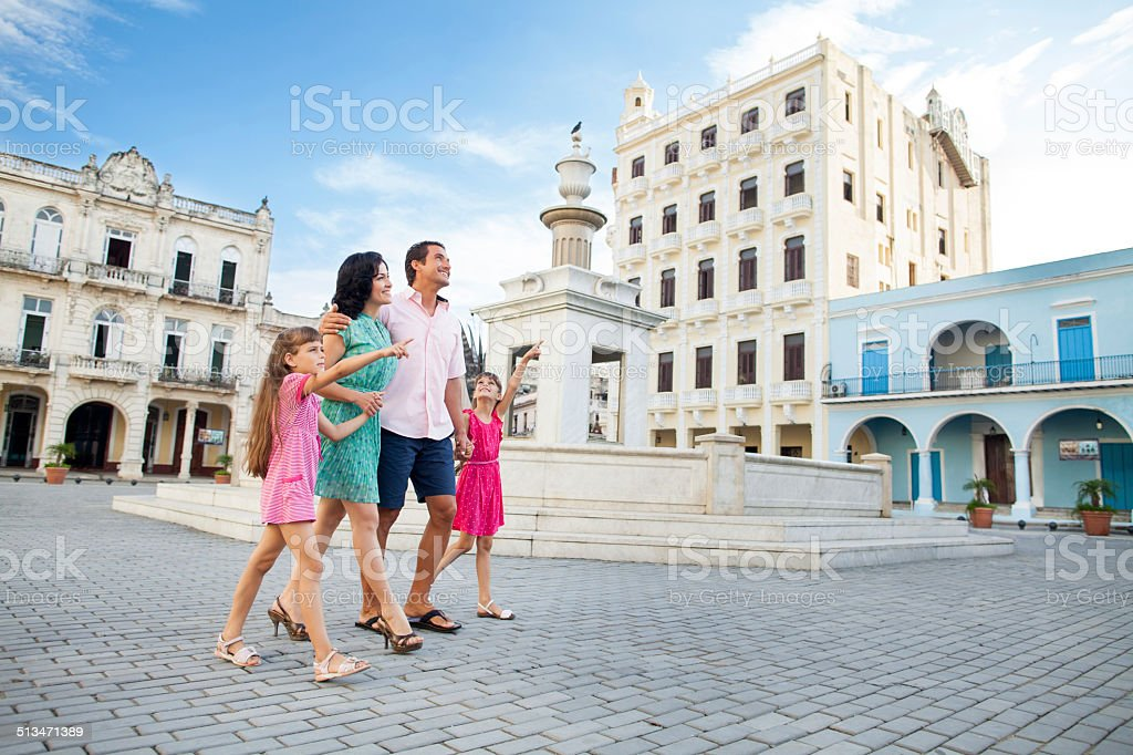 Girls lead family in downtown plaza stock photo