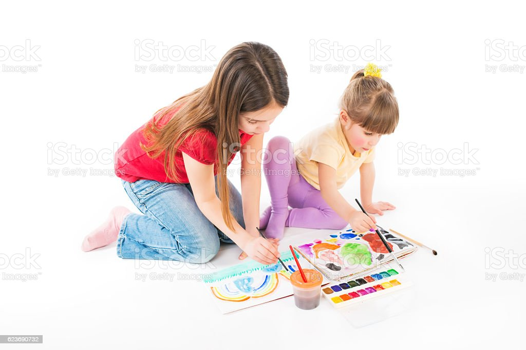 Girls Learning to Draw stock photo