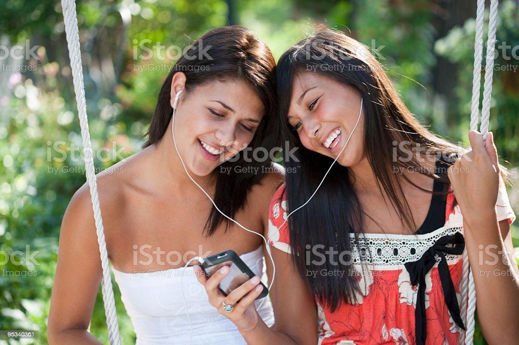 Girls listening to music stock photo