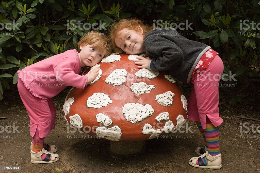 girls listening to silent toadstool, no dwarf at home royalty-free stock photo