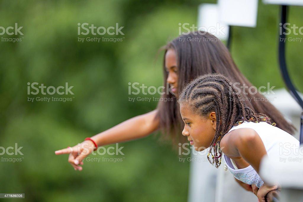 Girls looking downstairs stock photo