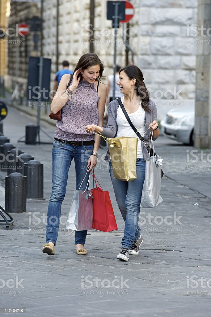 Girls looking in their shopping bag royalty-free stock photo