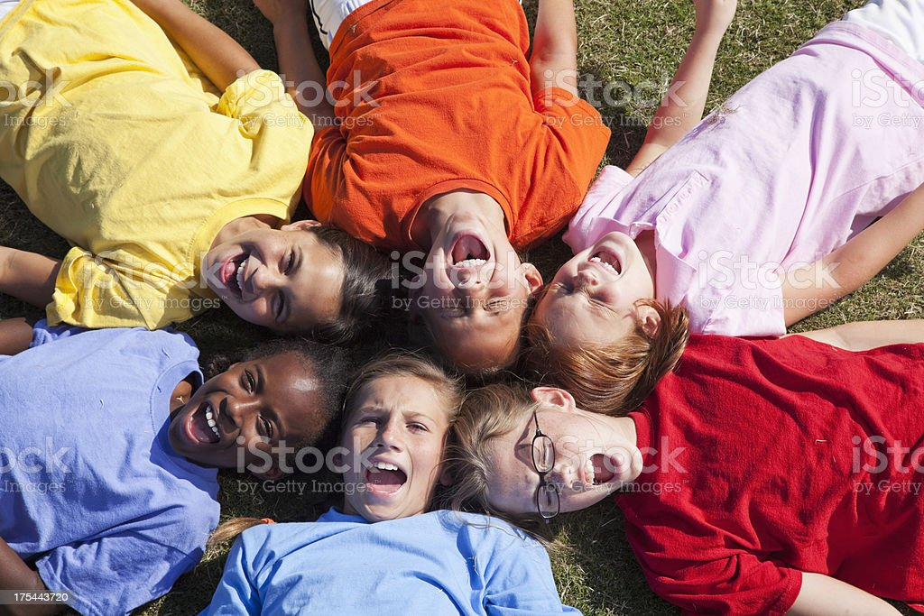 Girls lying in a circle looking up royalty-free stock photo
