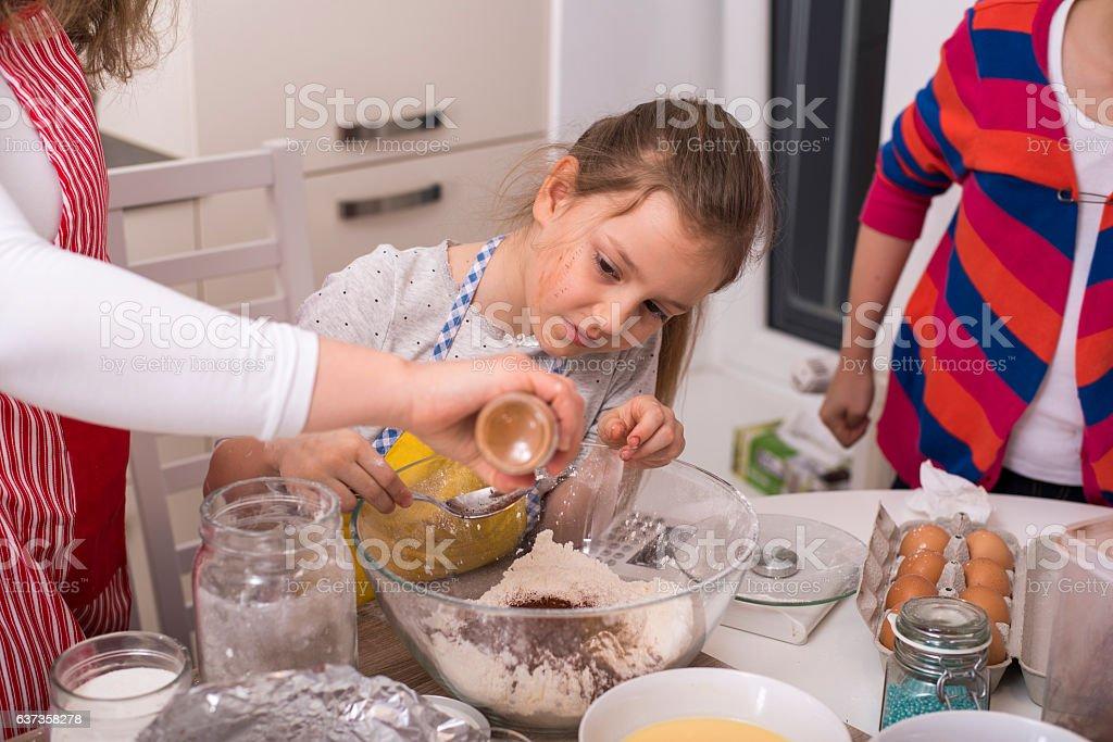 Girls making muffins stock photo