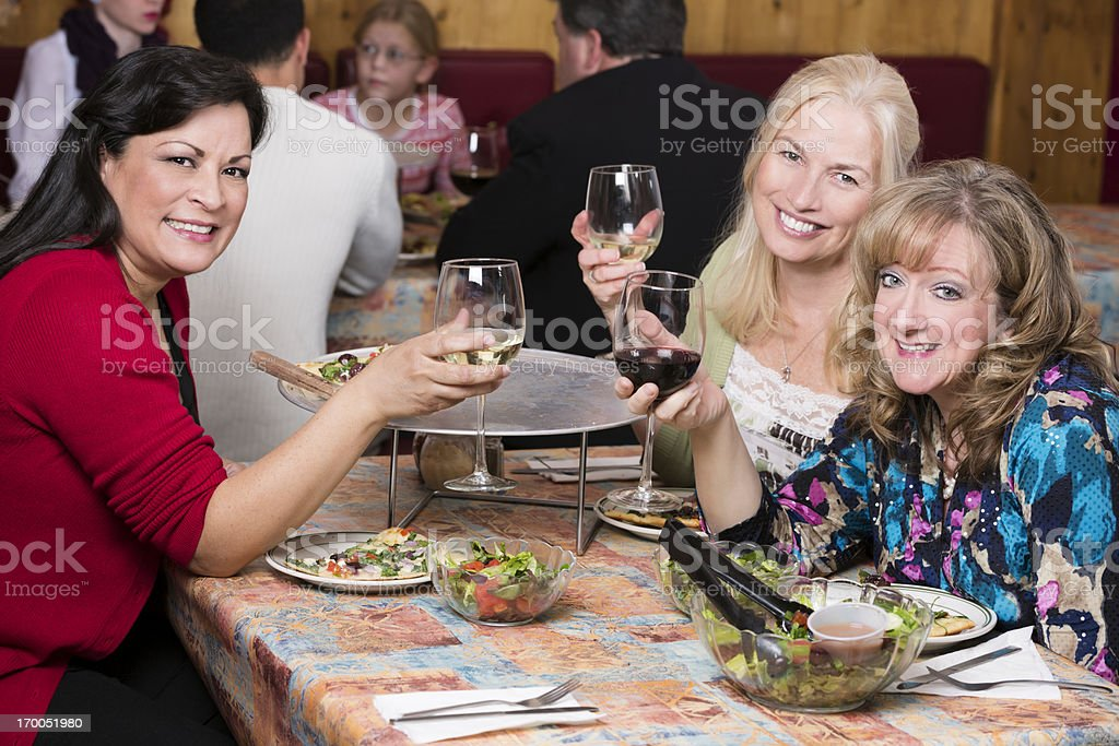 Girls night out at a pizza restaurant royalty-free stock photo