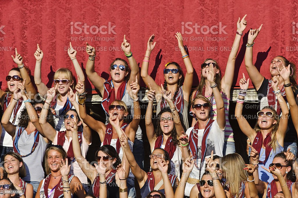 Girls of Torre city neighborhood in Siena are chanting stock photo
