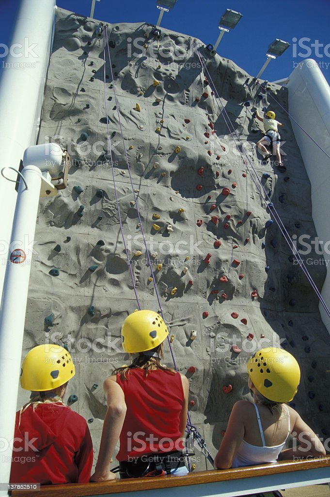 Girls on an outdoor climbing wall royalty-free stock photo